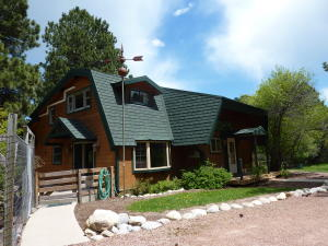 Lindahl Cedar Home has a new Girard lifetime metal roof