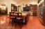 The arched entry to the left leads to formal dining room. Room for everyone - including the cook!