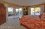 Tranquil master suite has gas fireplace and overlooks the pool