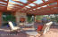 Relax on trellis patio for alfresco dining and stargazing