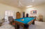 Large family/rec room w/separate bath & entrance may be used as bedroom or office.