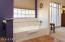 Large soaking tub, Saltillo tile, view window.
