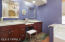 Dual separated vanities, inset lighting, makeup/seating area, cherry cabeintry.