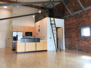Kitchen and bath with view of the loft space above