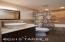 Slab granite, stone basin, contemporary faucet, high quality vanity, ceramic tile surrounds, and glass tile backsplash.