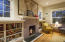 built-ins, woodburning fireplace, huge paned windows