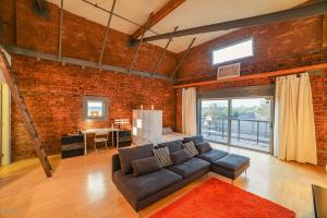 Great room, with lots of flex space, original brick walls, and high ceilings