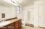 large master bath has full shower and tub combo