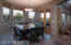 Breakfast Area with French Doors to Outdoor Living/Dining Room and Kitchen and Backyard