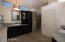 Bath renovated with slab granite, glass-enclosure tiled shower, updated mirrors and light fixtures.