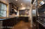 Kitchen outfitted with stainless GE Monogram appliances and Wolf 4-burner range.