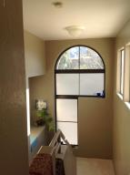 Looking downstairs from master bedroom arched east facing window