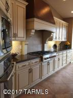 Quartz countertop work stations, under cabinet lighting, custom hood and so much more!
