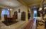 Formal dining room adjacent to kitchen.