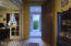 Entry foyer with den/office to the left - lovely double French doors.
