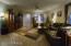 Great room w/guest bedroom hallway in far rear.