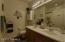 Guest bathroom also has dual sinks.