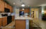 Ample cabinetry and large breakfast workspace island.