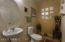 Highly desired powder room - great for guests & entertaining.