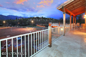Two wonderful homes on hard to find horse property in the lower foothills adjacent to the Rillito River Loop!