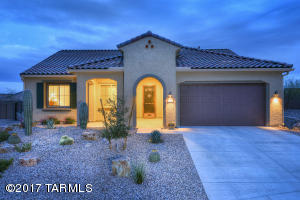 Lovely and popular Pursuit model at Del Webb. Unique extended front patio/porch.
