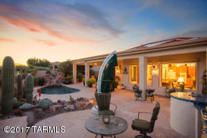 Sunsets and Catalina Mountain Views await you from this fabulous backyard.