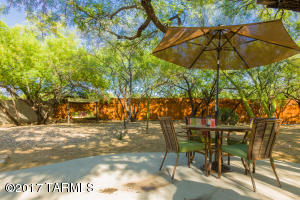 Enjoy the lazy days of summer in this shaded back yard