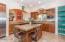 Custom cherry cabinets, granite countertops.