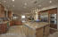 Huge island! Lots of cabinets, lovely granite, double ovens, special lighting and character!