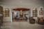 Notice the huge archway into the living room. Niches with wood shelves on both sides. A wonderful space!