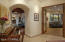 """Wide open """"hallways"""" allow room for a piano. Notice the beautiful doors and archway."""
