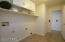 Very spacious laundry room with storage and closet
