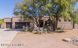 THIS BEAUTIFUL HOUSE HAS A 3 CAR GARAGE (A MUST HAVE IN AZ) AND TO THE LEFT OF THE PICTURE IS A LARGE DOUBLE GATE TO BACKYARD