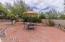 Patio area in backyard near pool.