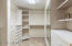 Walk-in closet with built-ins in Master Bedroom.