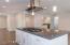 Soft-close cabinets, slab granite counters.