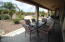Enjoy your beautiful resort style backyard from your covered porch.