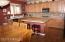 Gas Range, granite tile counter tops and under cabinet lighting.