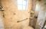 Amazing remodeled guest bath with quality finished and stone tile