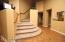 leading to the 3 upstairs bedrooms, loft area and bonus room
