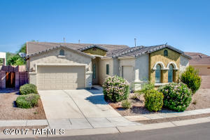 Situated on quiet cul-de-sac in Oro Valley's Somerset Canyon in Rancho Vistoso, backing to natural buffer & Vistoso Golf course, this one -story 4BR/2BA+3 car garage has it all