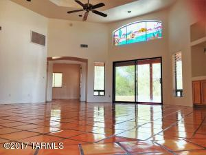 As you enter the home notice the Refinished Flooring, Bright & Airy room & Soaring Ceilings