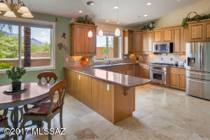 Gourmet kitchen has stainless appliances, casual dining area, breakfast bar & custom maple cabinetry.