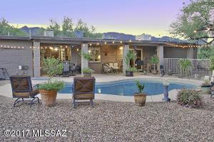 in this classic Ranch style home w/gated pool on over an acre.