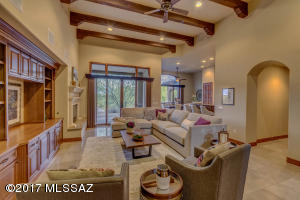 Great Room with High Ceilings and Exposed Beams, Inset Lighting, Stunning Entertainment Center