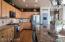 Undercabinet lighting, slide-out shelving, Pottery Barn light fixture, stainless appliances