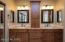 Dual vanity with slab granite, undermount sinks, oil-rubbed bronze fixtures