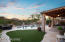 Turf yard and travertine paver patio