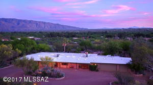Perched on 4.32 acres in the lush Tanque Verde Valley surrounded by natural desert