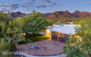 Outstanding back area of home with room for entertaining, relaxing; so much room to play!...All under the backdrop of Sabino Canyon in the Catalinas.